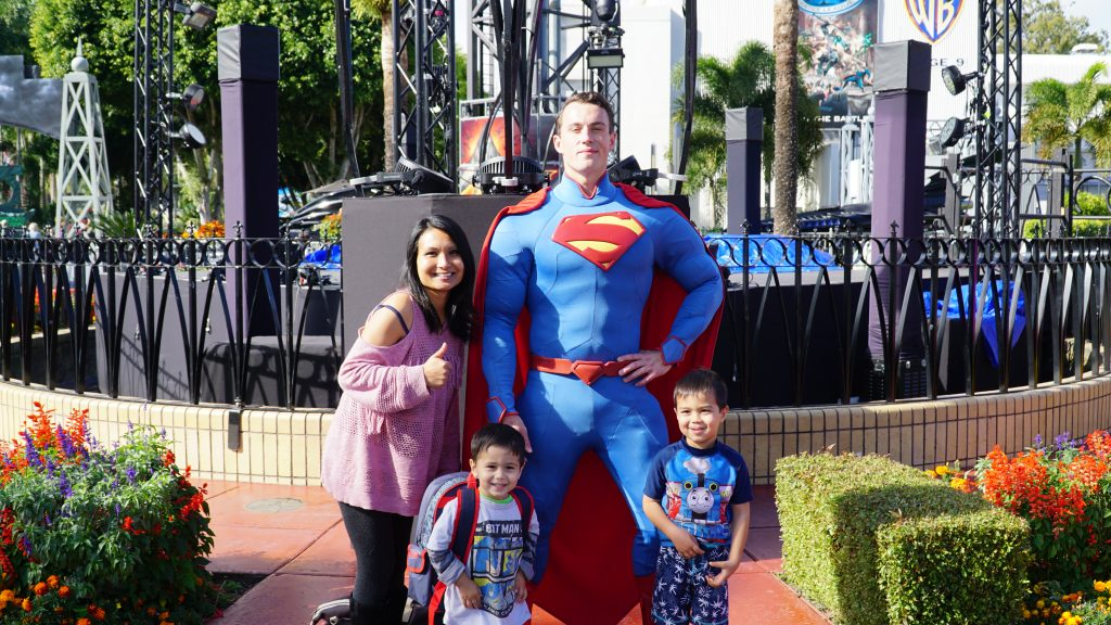 Family posing with Superman at Movie World