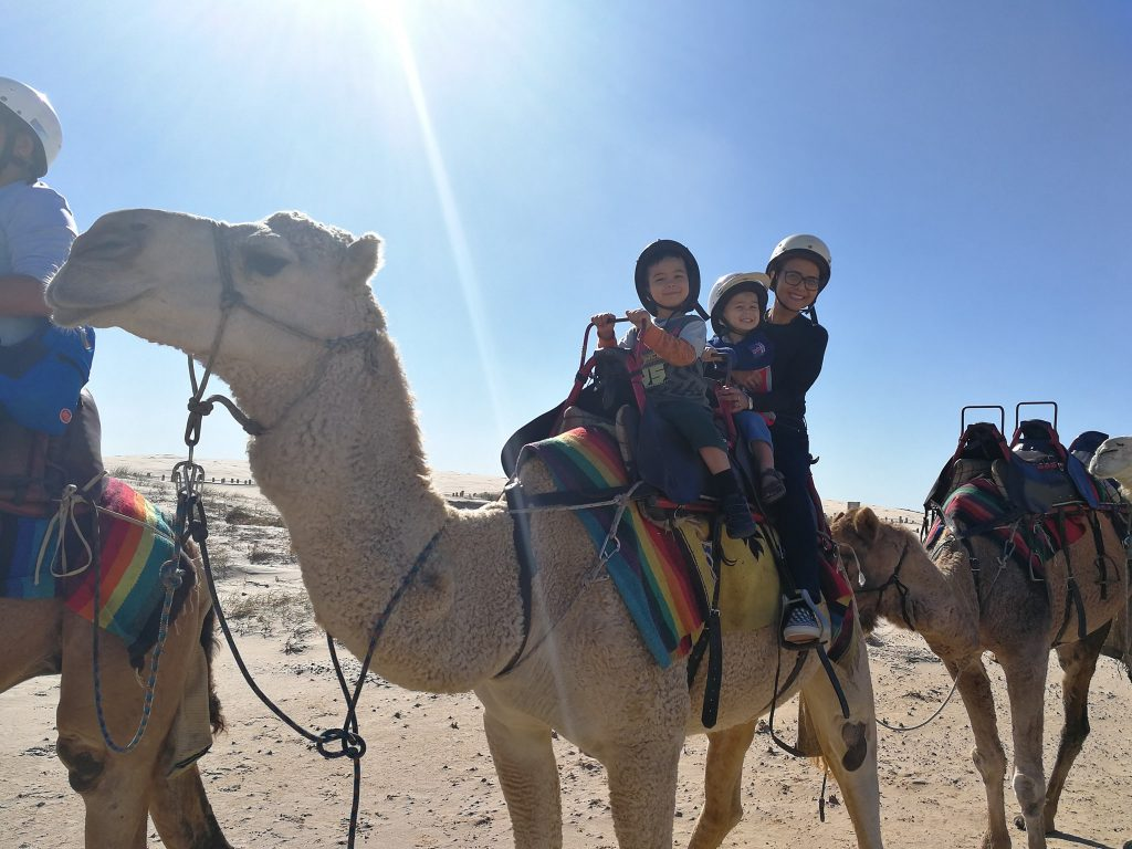 Kids riding Camel